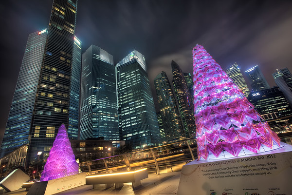 Photograph: Christmas At Marina Bay - Novelty, charity, christmas tress along Marina Bay in Singapore.
