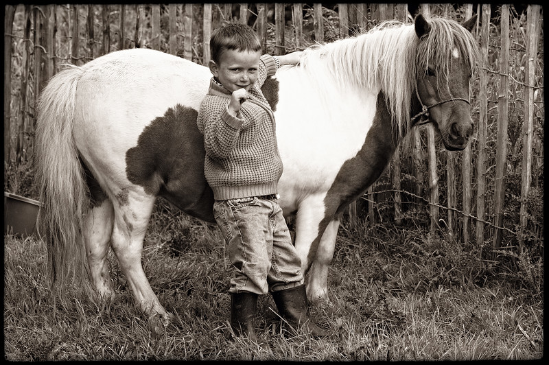 YOUNG BOY WITH PONY