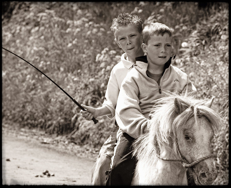 TWO BOYS ON HORSE