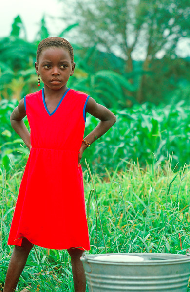 GIRL IN RED DRESS, ZAMBEZI VALLEY ZIMBABWE