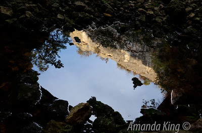 Reflection in puddle on cave floor, it was so clear that if I turn it the other way up it looks like the real sky and rock face.....
