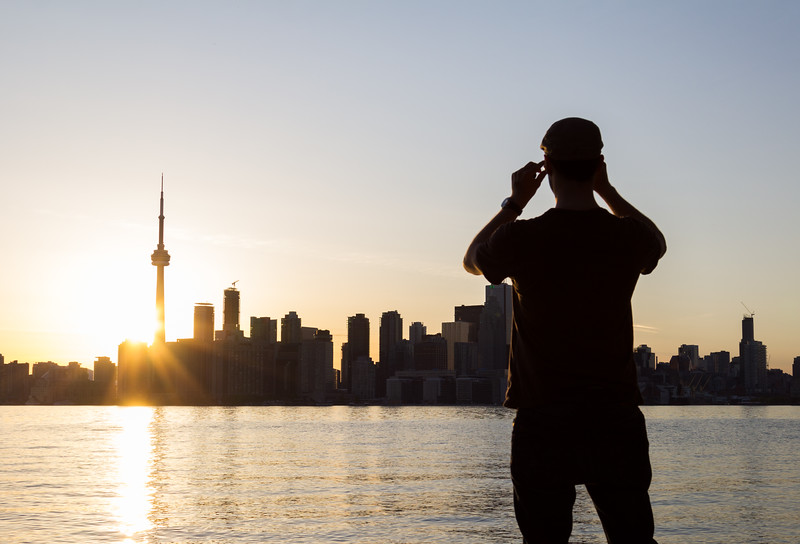 Man taking a picture of Toronto from the Islands