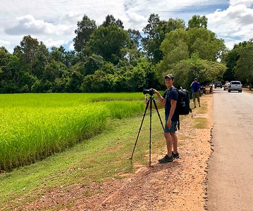 Me along Cambodian Route 67 taking photos of a glorious Angkorian rice field in full bloom (photo by Boren)