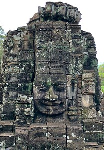 Closeups of the smiling face of  Jayavarman VII appear alive at times and attempting to communicate