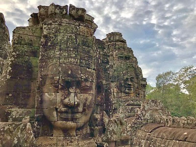Closeups of the smiling faces of  Jayavarman VII appear alive at times and attempting to communicate