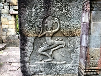 Well preserved dancing aspara carved into a sandstone pillar with original red pigments in The Hall of Dancers