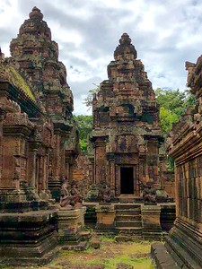 Banteay Srei libraries and their courtyard, four monkey-human Garuda statues at each entrance, many asparas and elaborate reliefs