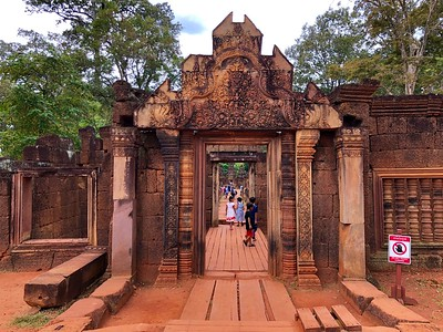 Main entrance to Banteay Srei and adorable children playing about