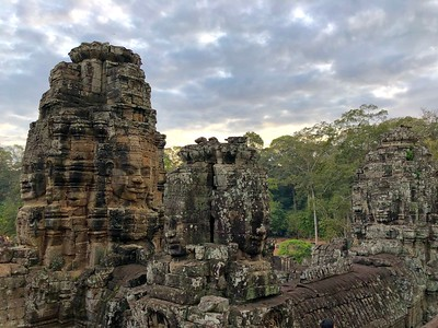 Smiling faces of Jayavarman VII on the Towers of Bayon and upper terrace