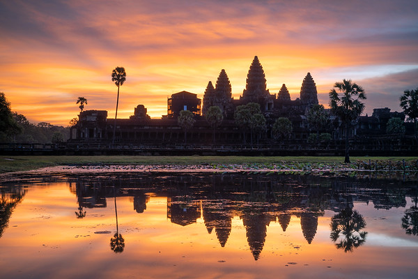 "#3: 5:49 AM || The sun begins nearing the horizon behind Angkor Wat brightening the already explosive orange and red colors while some blue lingers (f/10, ISO 50, 2.5"" )"