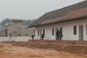 A tourist enters reconstruced Building 8 of the palace site at Yanshi Shangcheng (Tazhuang, Yanshi, Henan, CN - 10/29/13, 10:12:18 AM)