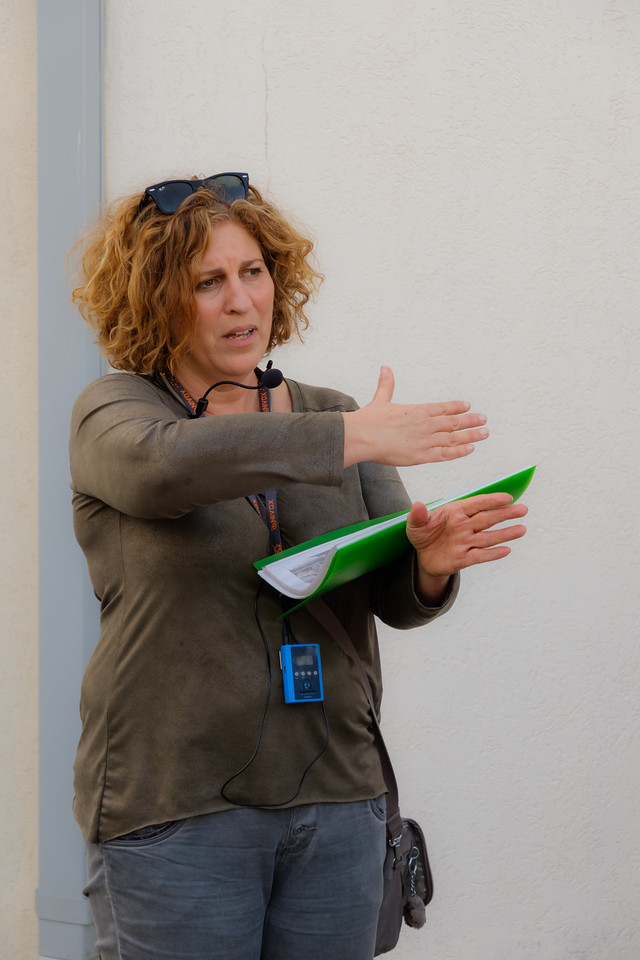 Tamar Tuchler, Regional Director of the Tel Aviv<br /> District & Head of the Dept. of Int'l Affairs, Society for the Preservation of Israeli Heritage Sites, leading a Levant Fairgrounds walk