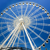 White Ferris Wheel in contrasting blue background - Pensacola Beach,Florida - USA