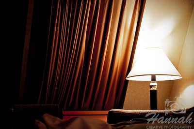 Interior of a hotel room viewing a window and a lampshade.  © Copyright Hannah Pastrana Prieto