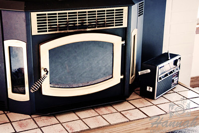 Antique fireplace with a very old transistor radio on the side  © Copyright Hannah Pastrana Prieto