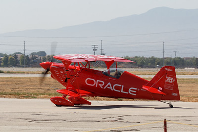 The Oracle Stunt Plane taxiing on the runway at the Planes Of Fame Air Show