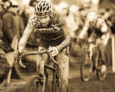 Crowd favorite and cycling legend Erik Tonkin (#129) (Kona) powers through one of many muddy sections at the USA Cycling Cyclo-Cross Nationals in Bend Oregon on December 12, 2010.  Powers ended up getting caught in a crash and finished 3rd overall.