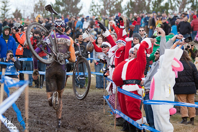 Crowd favorite, Kona's Ryan Trebon (#54) runs past spectators dressed as Santa and doing the wave at the USA Cycling Cyclo-Cross Nationals in Bend Oregon on December 12, 2010.