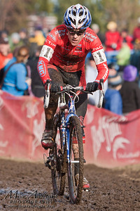 Colorado Springs, CO native and defending champion Katie Compton (#1) (Planet Bike) hammers through a slow mud section during the USA Cycling Cyclo-Cross Nationals in Bend Oregon on December 12, 2010.