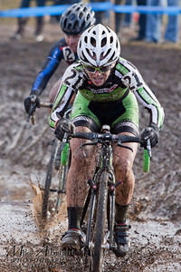 Cat2 race Kaitlin Antonneau (#21) (Cannondale P/B Cyclocrossworld) cruises through a muddy section during the USA Cycling Cyclo-Cross Nationals in Bend Oregon on December 12, 2010.