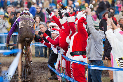 Crowd favorite, Kona's Ryan Trebon (#54) rides past spectators dressed as Santa and doing the wave at the USA Cycling Cyclo-Cross Nationals in Bend Oregon on December 12, 2010.  Powers ended up getting caught in a crash and finished 3rd overall.