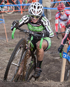 Cat2 race Kaitlin Antonneau (#21) (Cannondale P/B Cyclocrossworld) negotiates an uphill corner during the USA Cycling Cyclo-Cross Nationals in Bend Oregon on December 12, 2010.