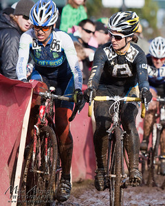 Anissa Cobb of Portland, OR (#66) (River City Racing) gets channeled into the fence by Christina Tamilio of Brighton, MA (#23) (Ladies First Racing)  during the USA Cycling Cyclo-Cross Nationals in Bend Oregon on December 12, 2010.