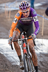 Kona's Ryan Trebon (#54) maneuvers his body through a fast, but tricky section at the USA Cycling Cyclo-Cross Nationals in Bend Oregon on December 12, 2010. Ryan finished 2nd overall in the Elite (Pro) category.