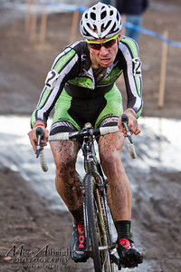Jeremy Powers (#2) maneuvers his body for a better position at the USA Cycling Cyclo-Cross Nationals in Bend Oregon on December 12, 2010.  Powers ended up getting caught in a crash and finished 3rd overall.