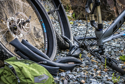 JRA - Demo bike equiped with XC-sidewalled tires + photographer with loaded pack awnting to stay smooth with constant contact with the ground = Double flat on a recon mission.   Luckily Bill and Sue from Ashland Mountain Adventures saved teh day sending me supplies on the trail.