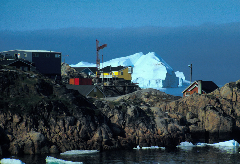 Ilulissat houses in front of icebergs