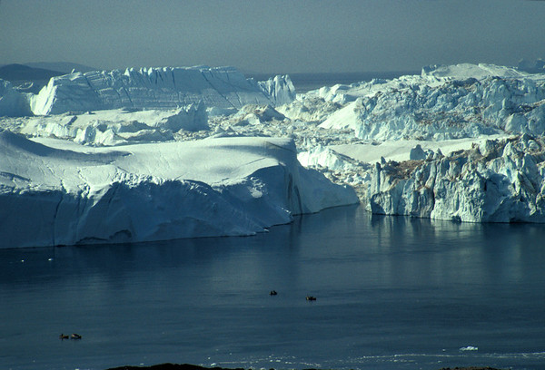 Ice fjord mouth with boats