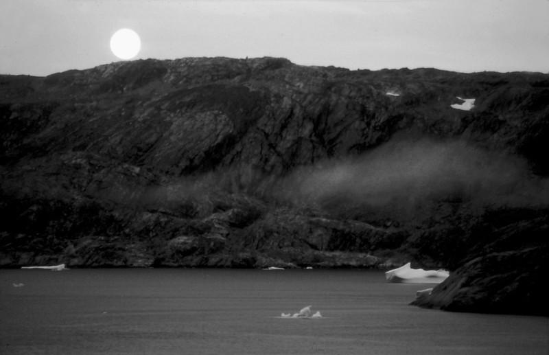Moon over Tasilaq fjord