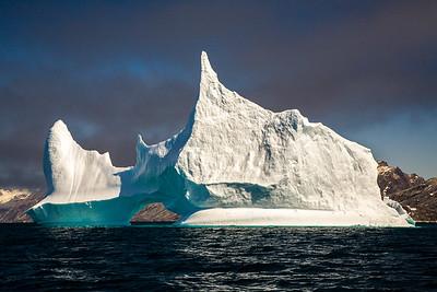 Iceberg under low clouds.