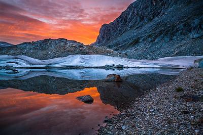 Sunset at small lake beklow the summit of Ungiartarpik.