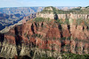 Oza Butte - with the strata layers of Kaibab limestone, Toroweap Formation (siltstone gypsum, limestone, and dolomite), Coconino Sandstone, Hermit Shale, and Supai Group - north rim of Grand Canyon