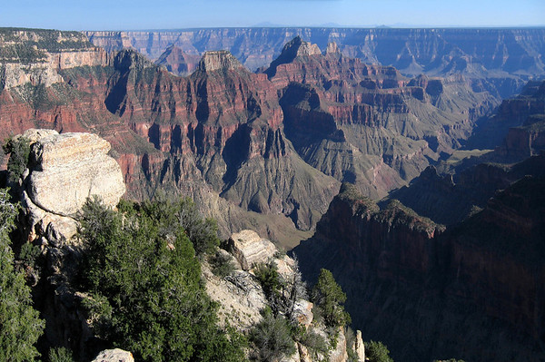 Bright Angel Canyon - to Obi Point (southwestern arm of Walhalla Plateau) - Deva Temple (Angel's Gate, distal L) - Brahma Temple (partially shaded) - and Zoroaster Temple - across the canyon to the South Rim - Grand Canyon National Park (1919), also A UNESCO World Heritage Site (1979), the largest canyon on Planet Earth (averaging 4,000 ft./1,219 m deep for its entire 277 mi./446 km winding length, and 6,000 ft./1,829 m at its deepest point and 15 mi./24 km at its widest) - Arizona.