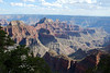 Across Bright Angel Canyon - to the Deva Temple, Brahma Temple, and Zoroaster Temple - with the south rim of Grand Canyon under the cumulus clouds, about 14 mi. (23 km) away - Grand Canyon - Arizona
