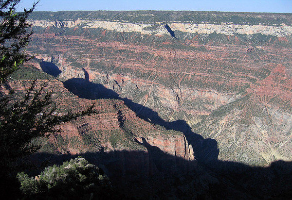 Across the shaded mouth of the Roaring Spring Canyon - to the sunlit eastern wall of Bright Angel Canyon (northern end of the Walhalla Plateau, where it fuses with the Kaibab Plateau) - Grand Canyon (north rim).