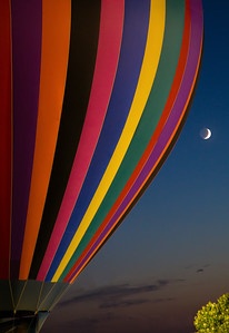 Evening balloon glow at sunset - moon rise