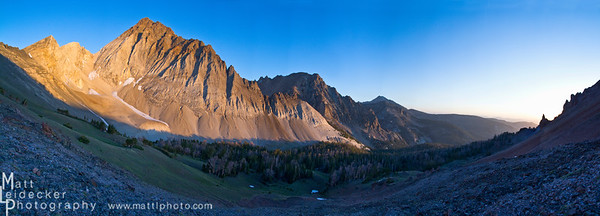 Sunrise lights up the east face of Castle Peak with Merriam peak in the shadows behind. Native image dimension - 20 x 55