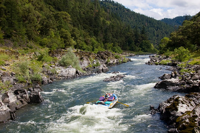 Page 37 - Flanked by Dothan sandstone, a raft takes a hit in Howard Creek Chutes (#3).