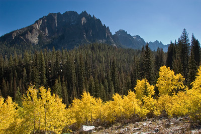 Yellow aspens and the Grand Mogul in the Sawtooth Mountains.