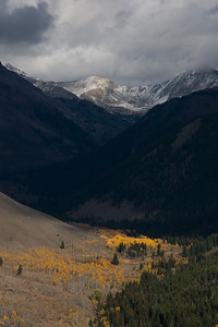 A fall storm highlights golden aspens high up Hyndman Creek Basin.