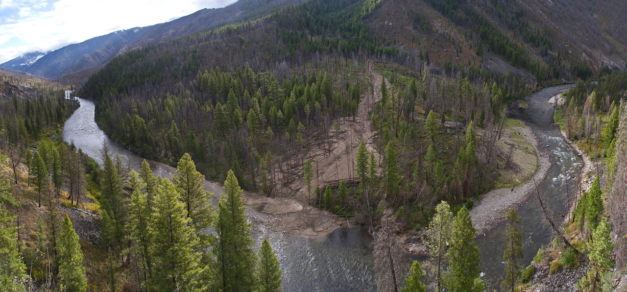 Wildfires have resulted in many landslides that have impacted the Middle Fork river channel.  This view is looking down onto two different slides below Sheepeater Camp.