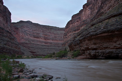 Clouds pick up some faint morning color as the river slips past camp.