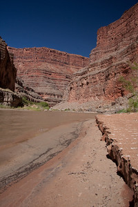 The sand mimics the canyon walls above.