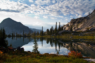 Sawtooth Mountains, ID - Morning light slashes across an un-named lake below the Queens/Little Queens River divide