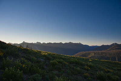 Sunrise on Picket Mountain with the high peaks of the Sawtooth Range in the background.