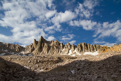 Clouds, shade, and serrated towers flank the Temple at the head of the Cramer Lakes Canyon.